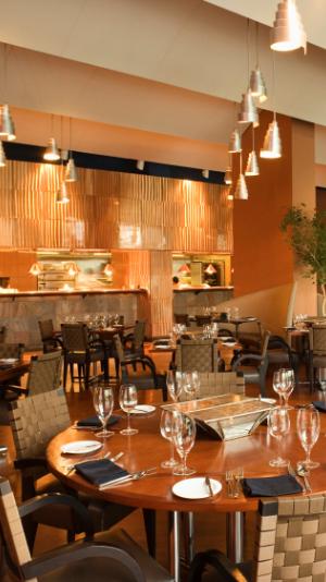 a fancy restaurant with golden wallpaper